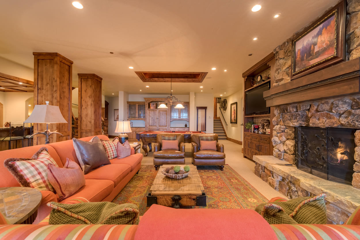 One floor down from the main living level is the family and game room, complete with a bar area