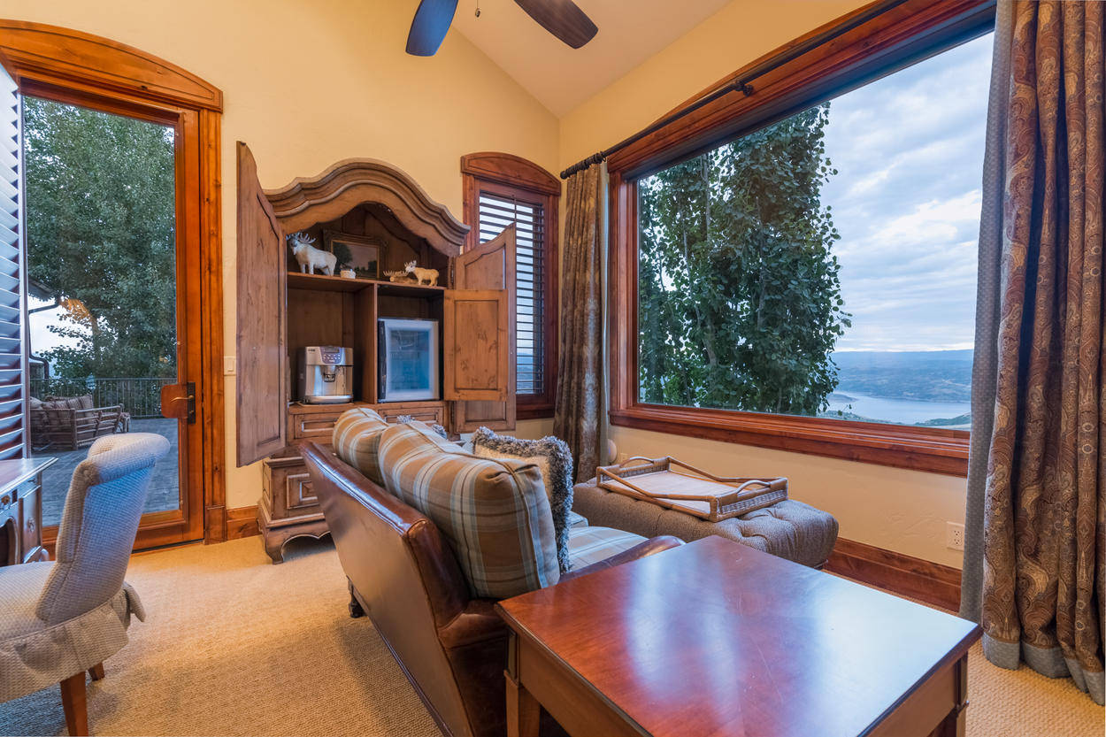 The private living area in the master suite offers a seat from which to gaze out at the falling snow
