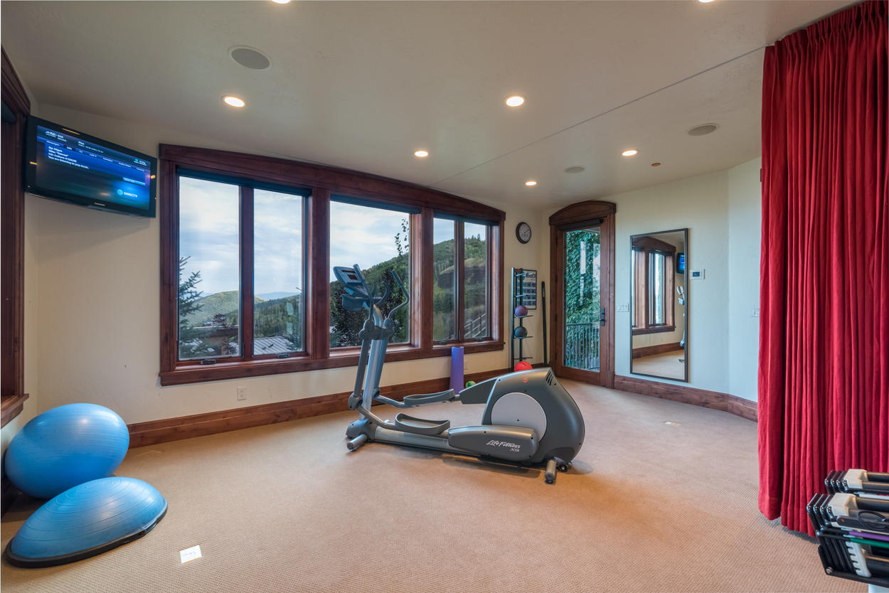 Keep up on your fitness goals on the elliptical, or pump some iron using the free weights in the home gym