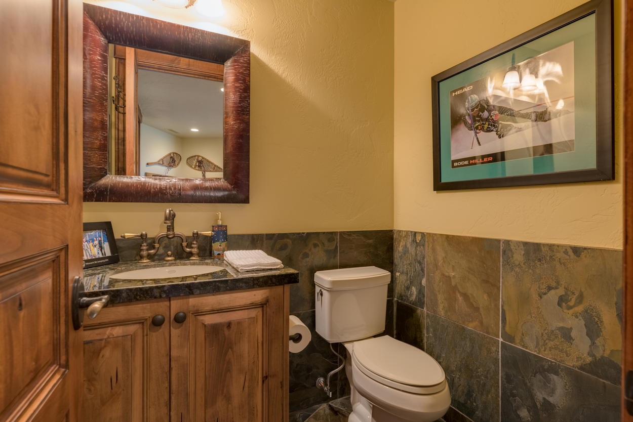 One of two powder rooms on the main living level ensure you won't have to stray too far from the shared living areas