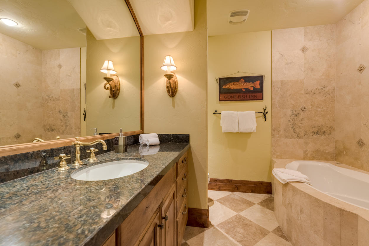 Guest bathroom 5 is ensuite and hosts a shower and separate soaking tub