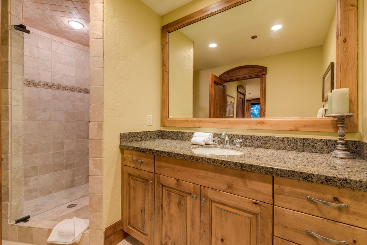 Guest Ensuite 4 offers a step-in shower and tasteful combination of granite, pine, and tile