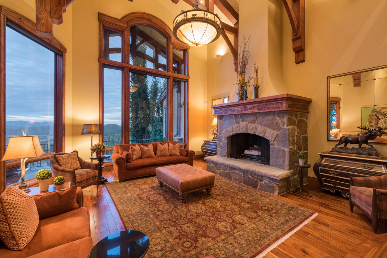 The more formal living room features huge picture windows and a gas fireplace