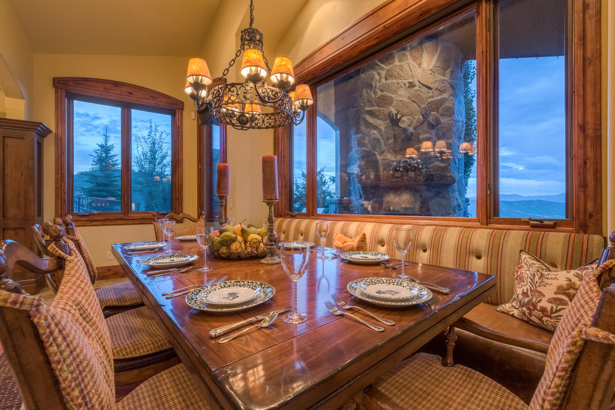 Have a seat at the wooden dining table to enjoy the fruits of your labor