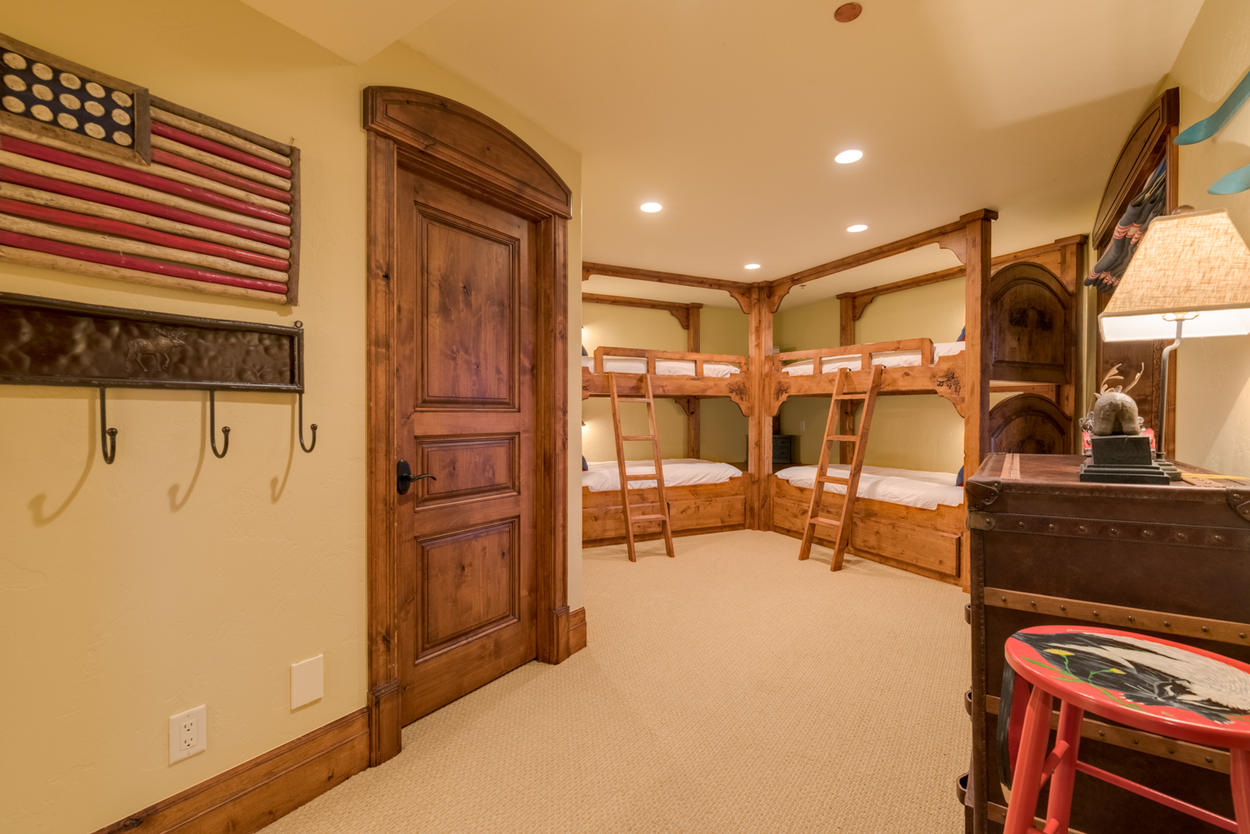 The bunk bedroom in this home holds two built-in bunk beds, sleeping 4