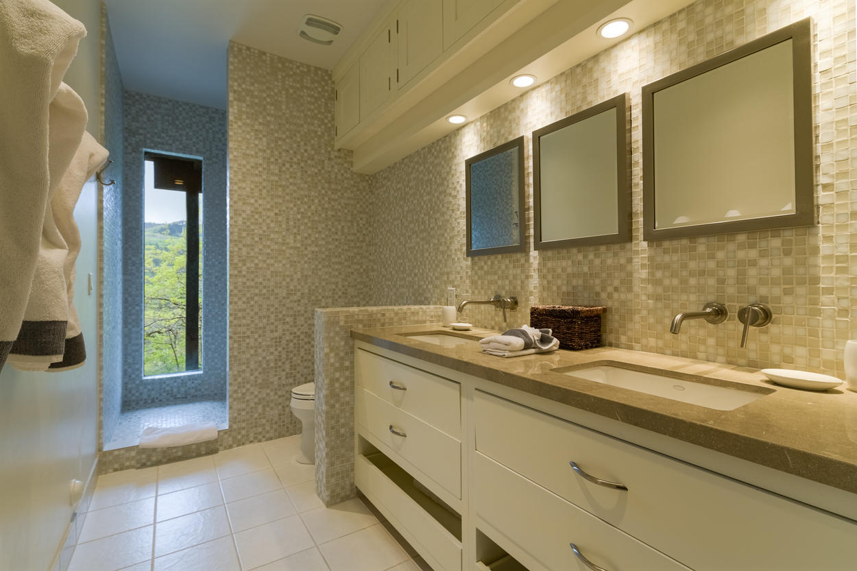 The Master Bedroom's attached ensuite has two modern sinks and a luxurious walk-in shower.