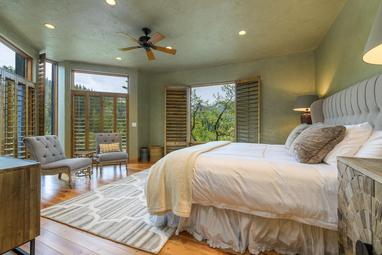 The Master Bedroom, on the lower level, has a king-size bed, amazing views, and its own attached ensuite bathroom.