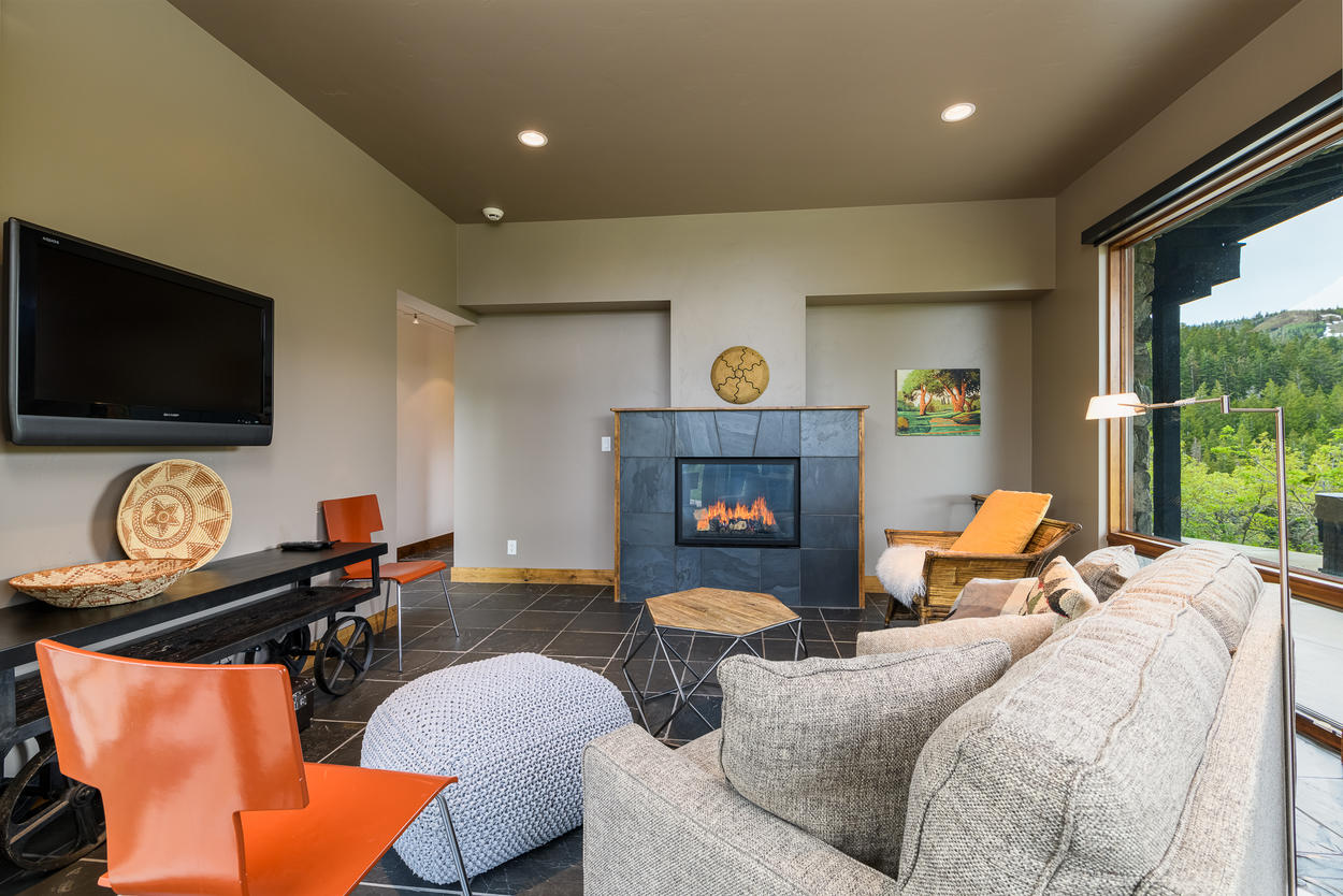 The second lower level living area has a cozy gas fireplace and plenty of seating.