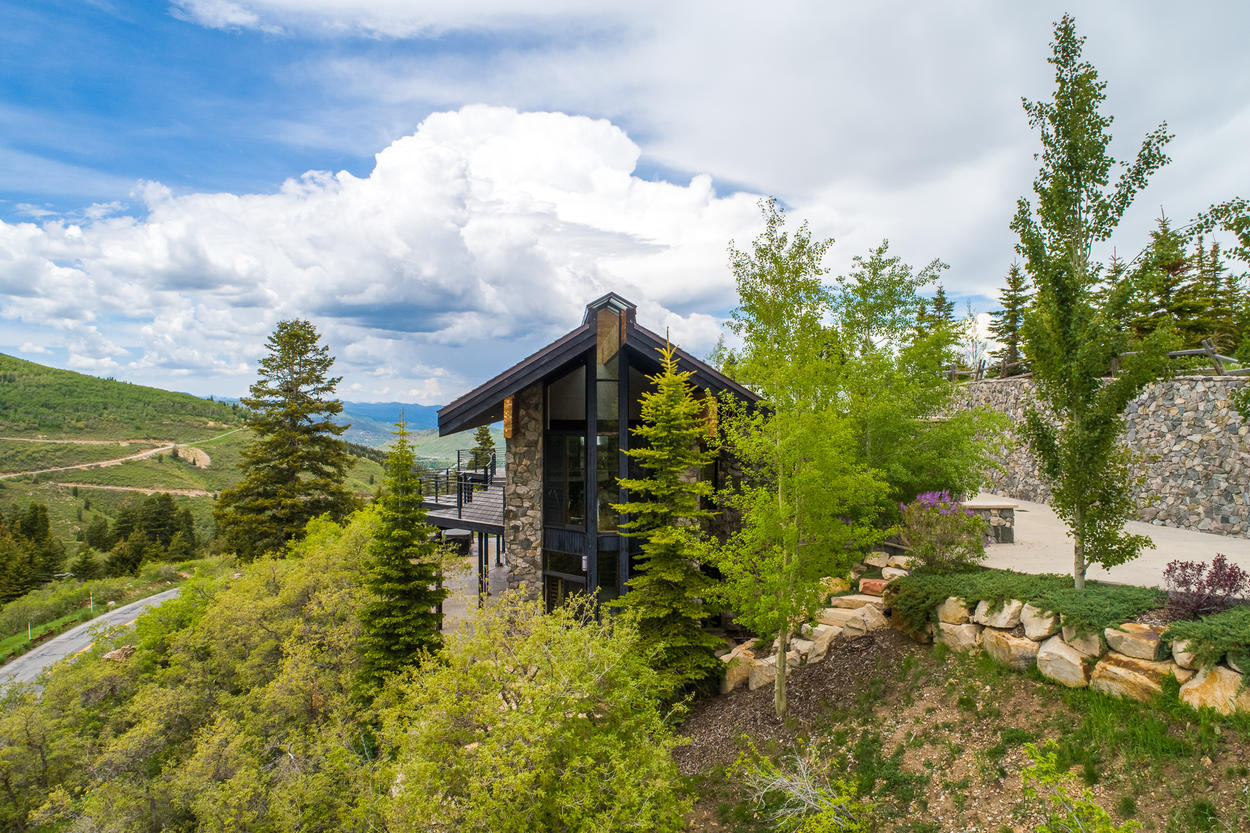 Trees surround this mountain modern home.