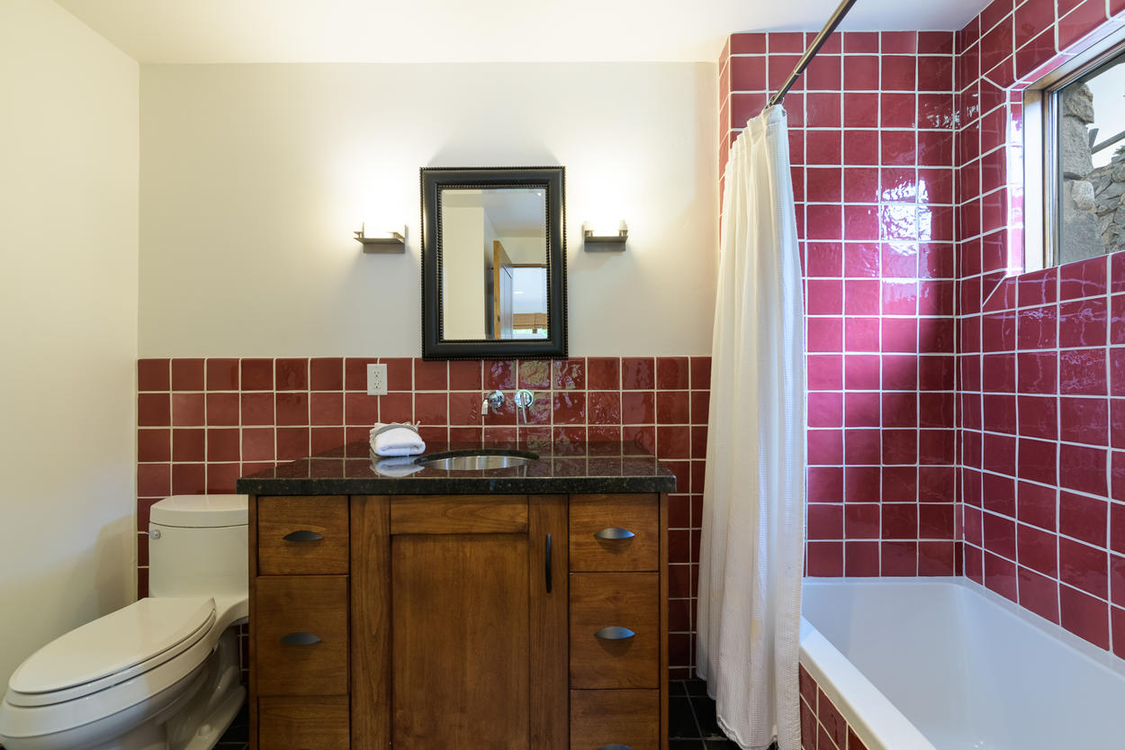 The fourth guest bedroom's attached ensuite has a shower/tub combination.