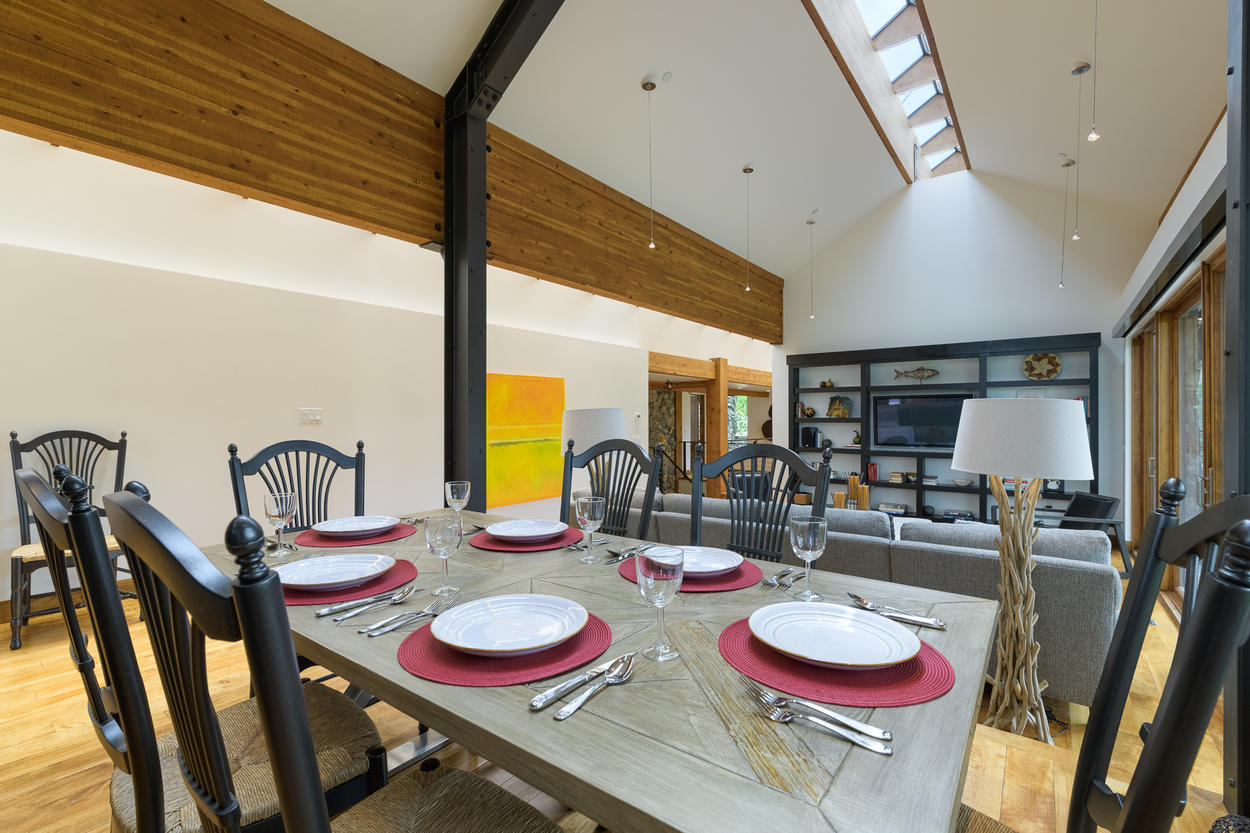 The dining area is a part of the main living area's open concept design.