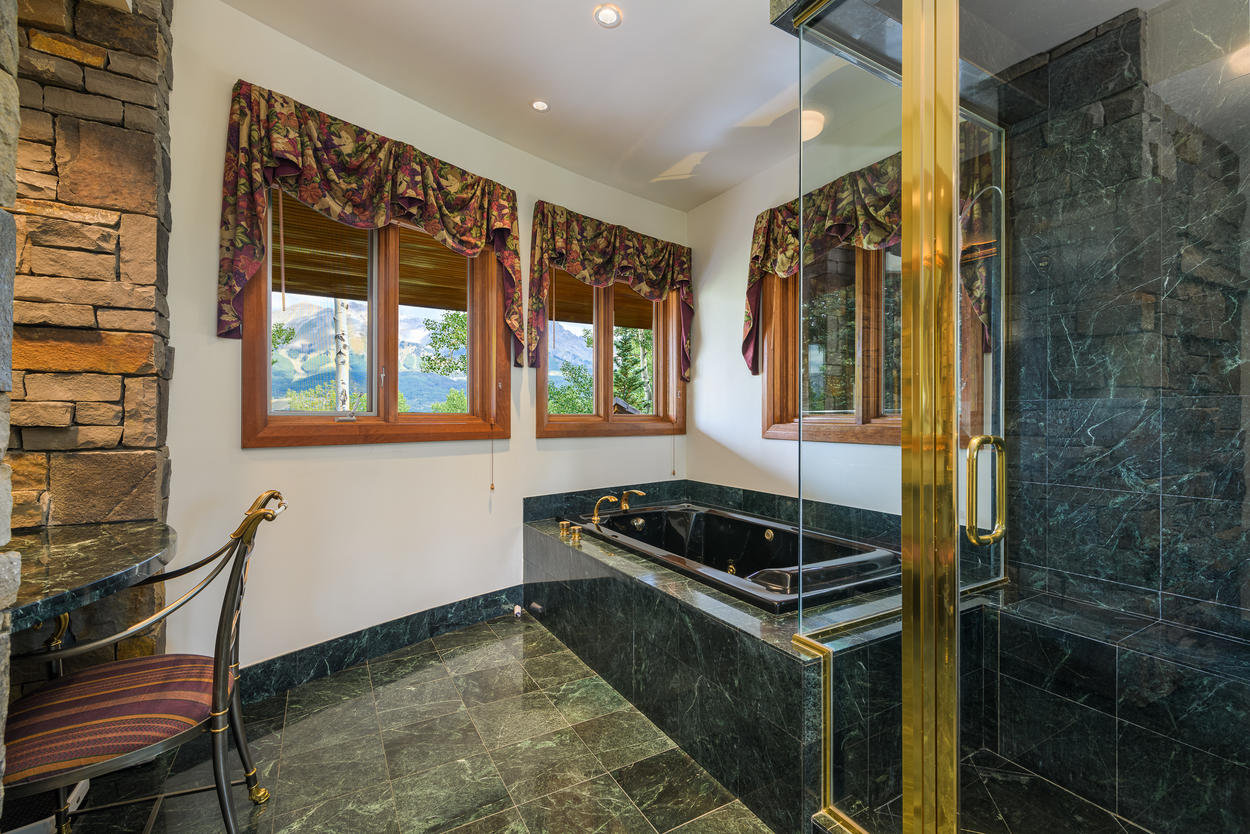 The Upper Level King ensuite has a large jetted tub and a walk-in shower.