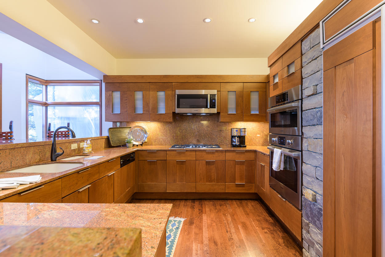Counter space surrounds the kitchen, providing plenty of room for prep and cooking.