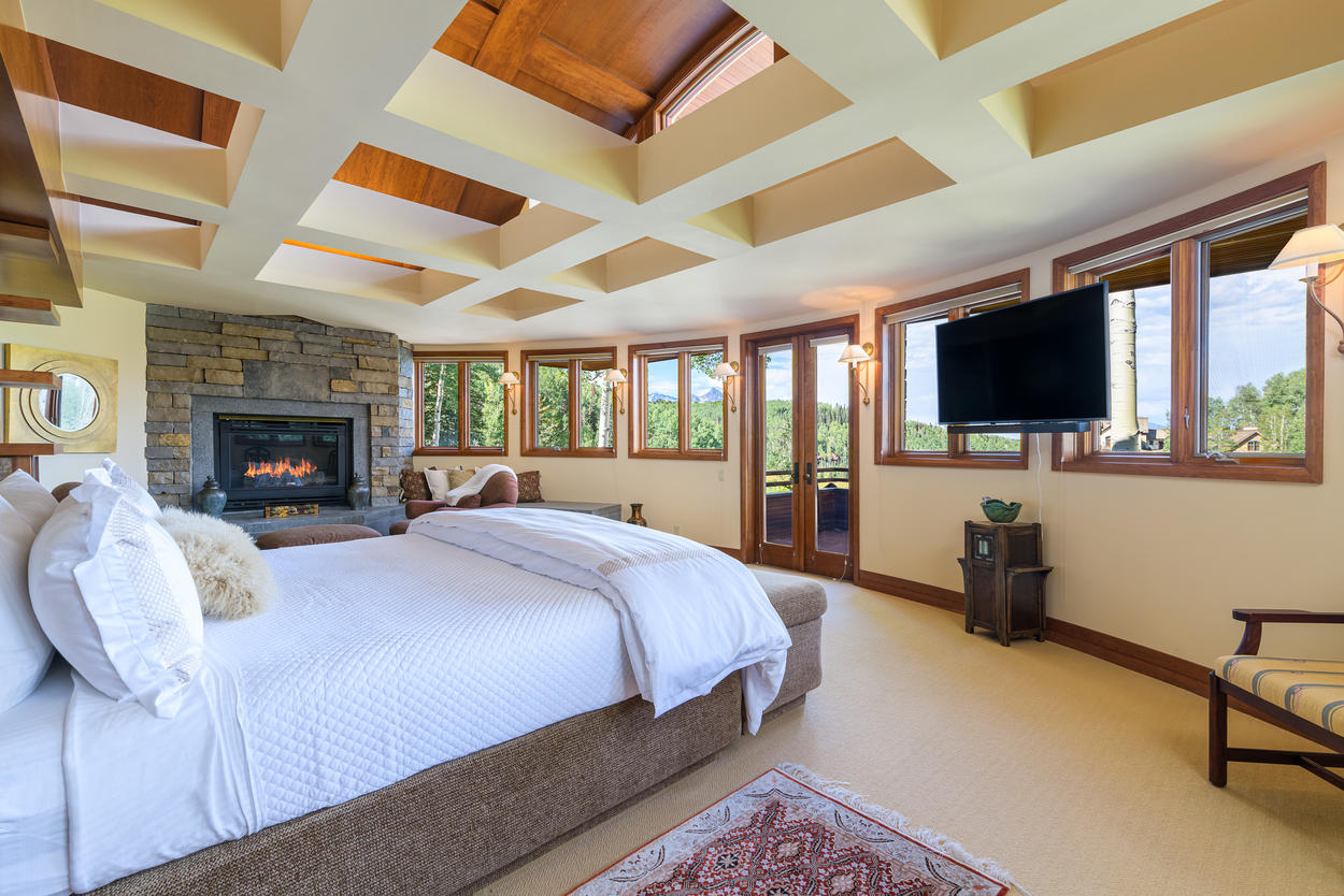 Windows surround the king-size bed in the 3rd floor Master, which has its own fireplace and deck.