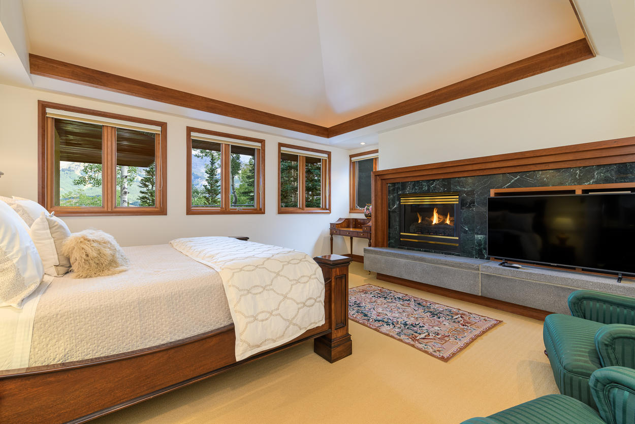 The Upper King Bedroom on the third floor has a king-size bed and gas fireplace.