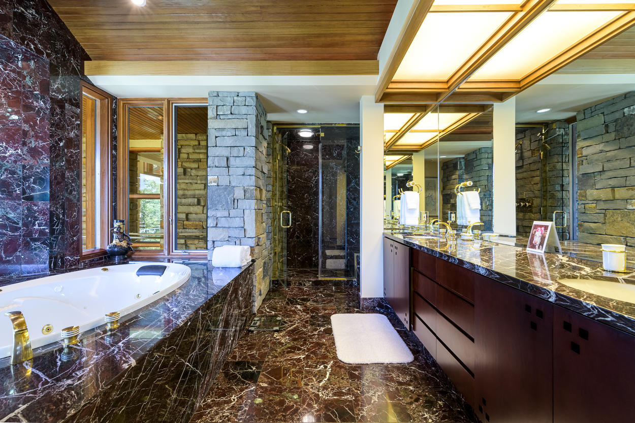 The 3rd floor Master Bath has a huge double vanity and a walk-in glass steam shower.