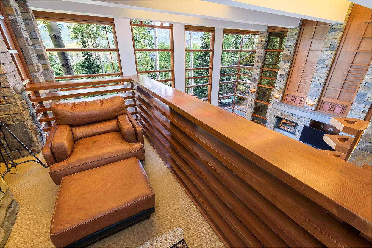 The loft above the living room has plush leather seating.