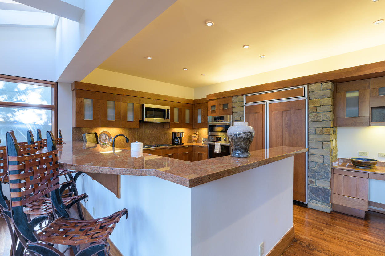 The kitchen has a breakfast bar with seating for four guests.