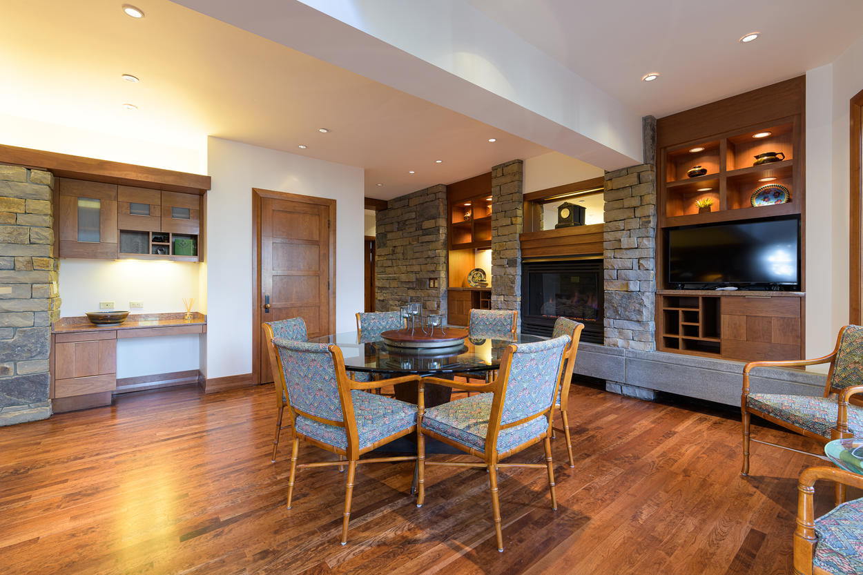 The dining area is just off from the kitchen, and features a round table with seating for eight.
