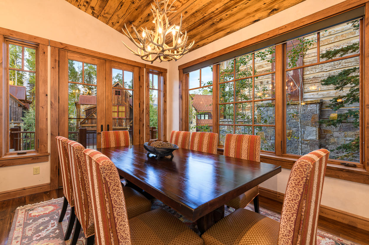 The dining table has seating for eight guests.