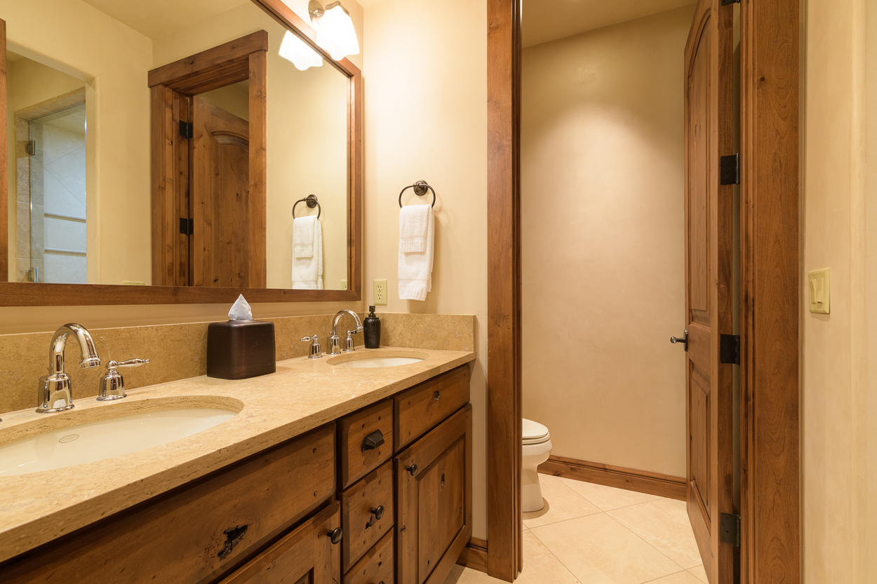 The lower level queen's ensuite has a double vanity and walk-in shower.