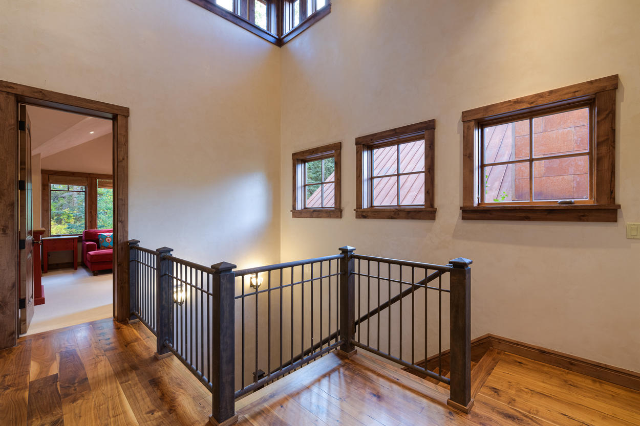 The landing at the top of the stairs leads to the Master Bedroom and the Trundle Room.