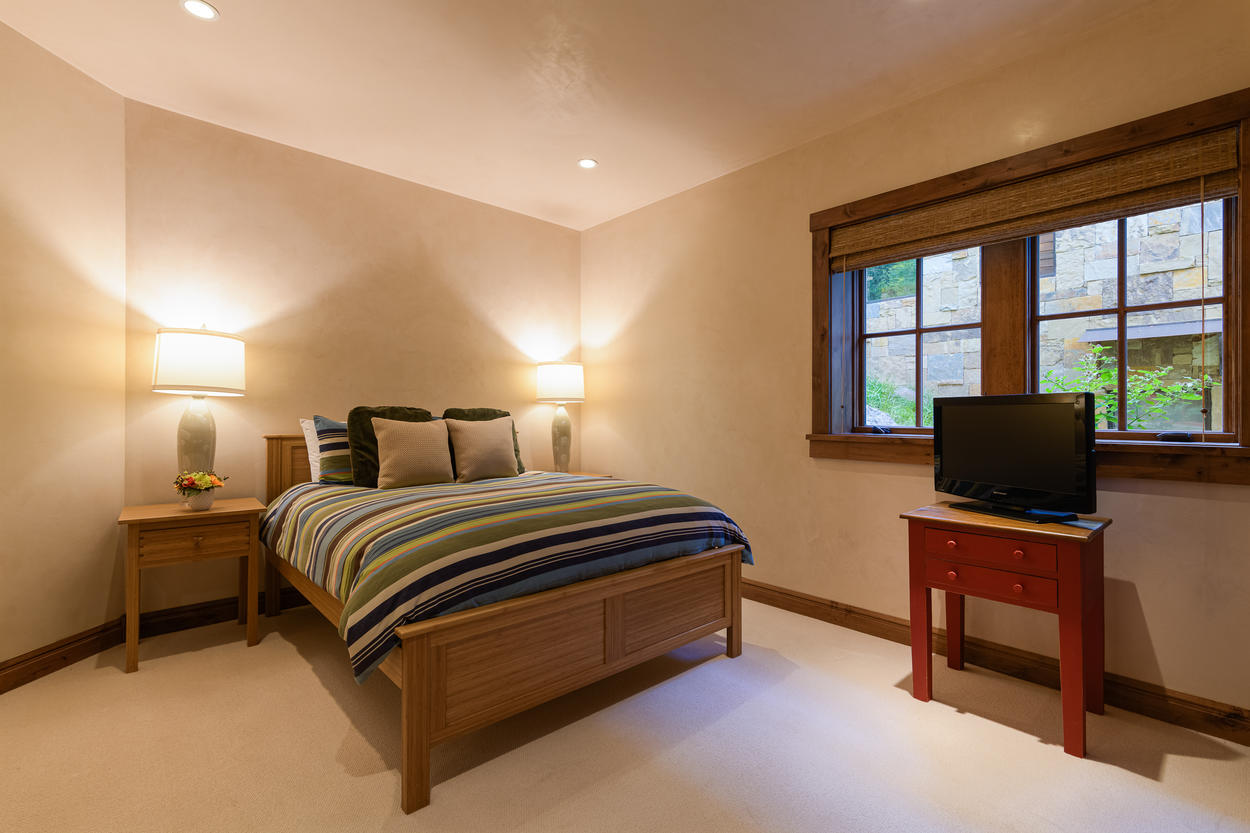 The lower level Queen Room has a TV and an attached ensuite bathroom.