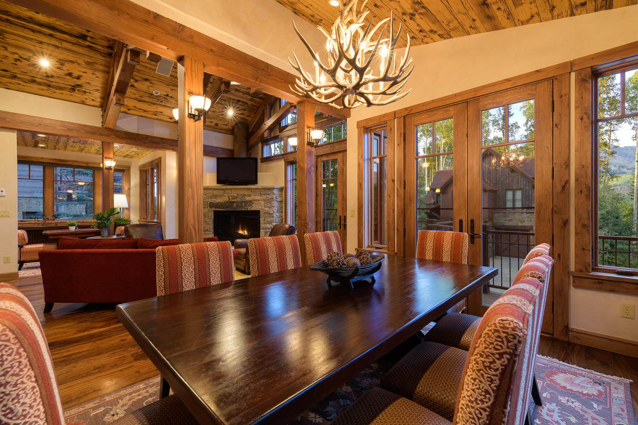Large windows surround the dining table, letting Telluride's beauty stream into the room.