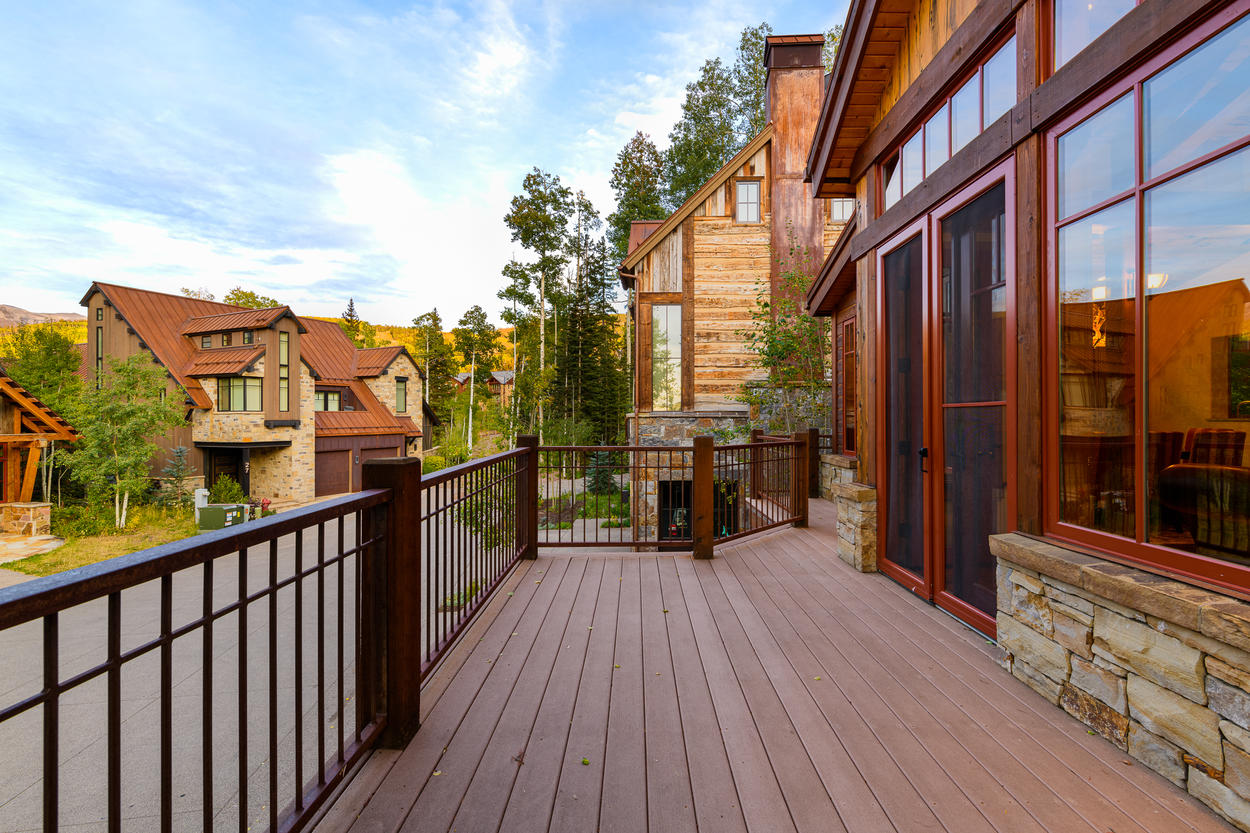 From the main living room, step onto the outdoor deck, which runs the length of the entire home.