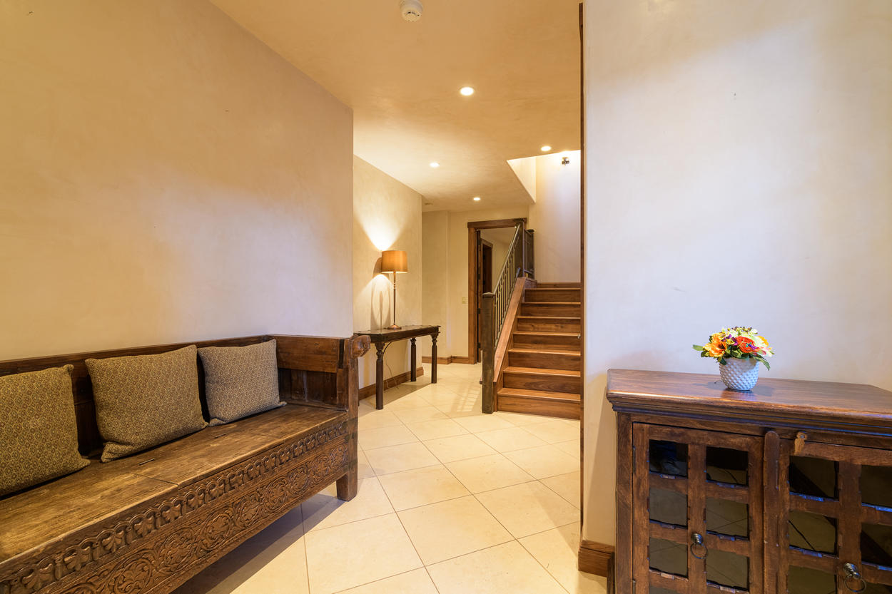 Enter the home through the lower level entryway.