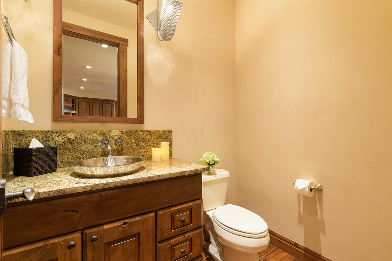 On the main level, there's a convenient powder room located across from the kitchen.