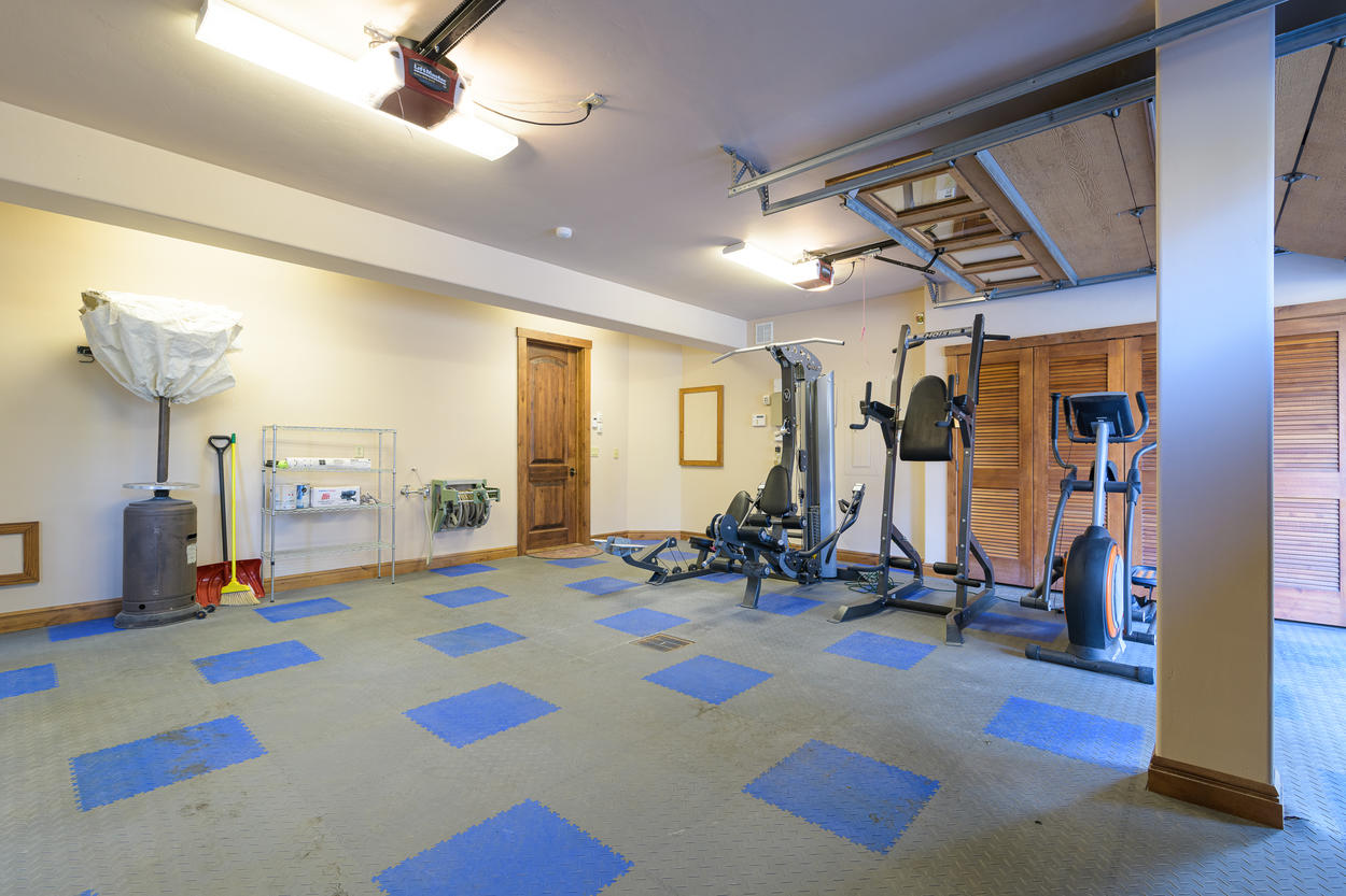The garage includes a workout area as well as room for one car.