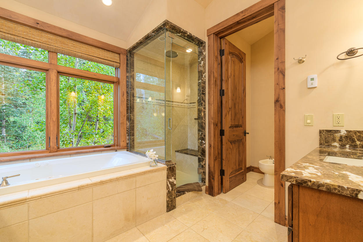 The Master Ensuite also features a glass walk-in shower and bidet.