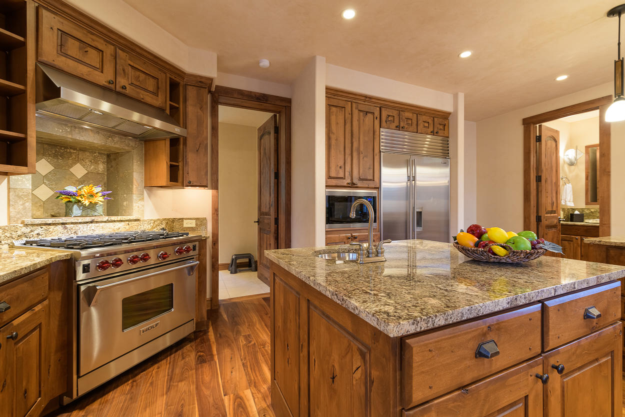 Throughout the kitchen you'll find top-of-the-line amenities, such as the 8-burner Wolf gas range.