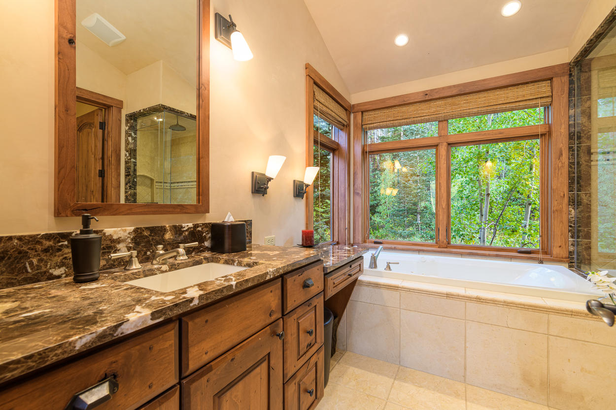The Master Ensuite has a large tub with views of the forest, and separate walk-in shower.