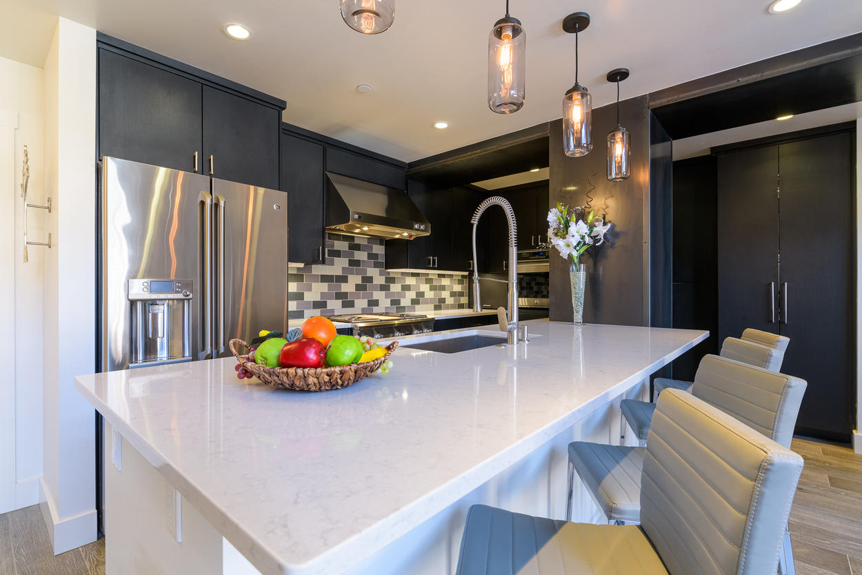 The kitchen has a large island with plenty of counter space for prepping and cooking.