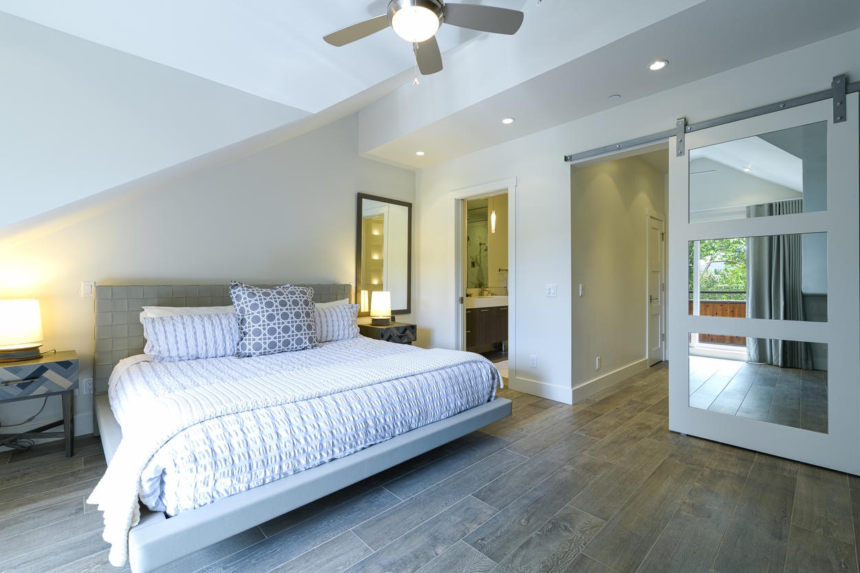 The Master Bedroom is located on the second level and has a king-size bed and attached ensuite bathroom.