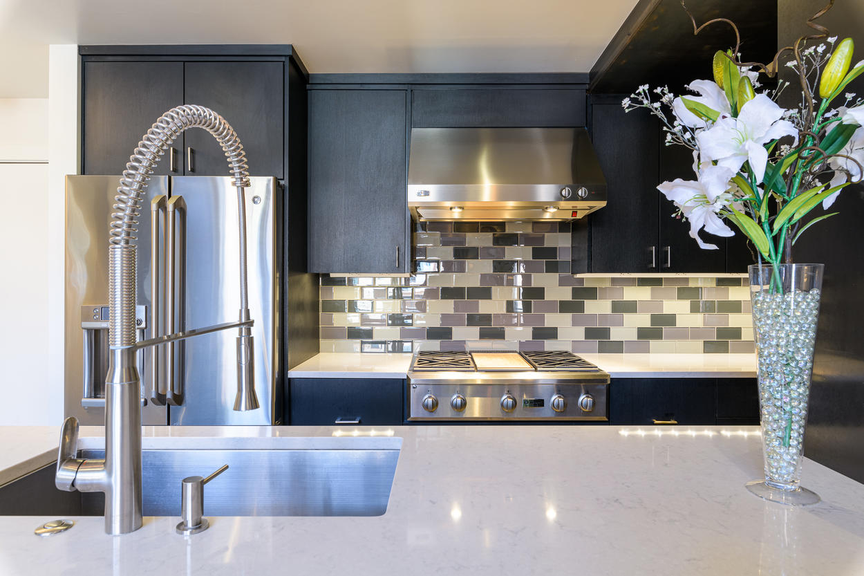 The kitchen is outfitted with gorgeous stainless steel appliances.