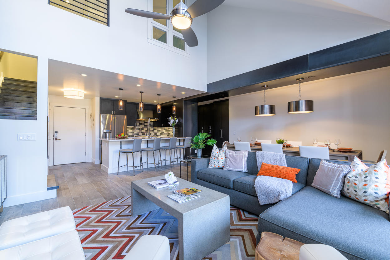 The main living area backs up to a breakfast bar near the kitchen, which has additional seating for four guests.