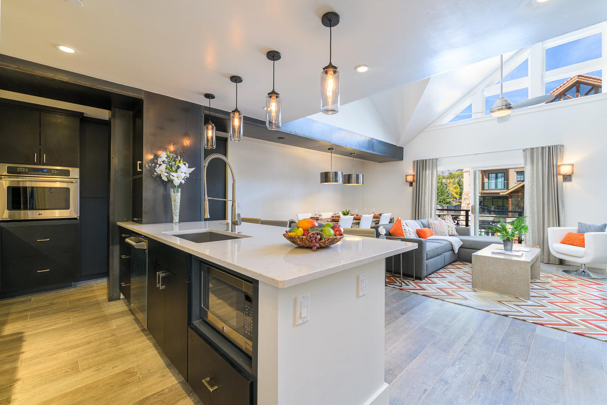 The open concept design lets all guests hang out together, whether they're in the kitchen, living room, or dining area.