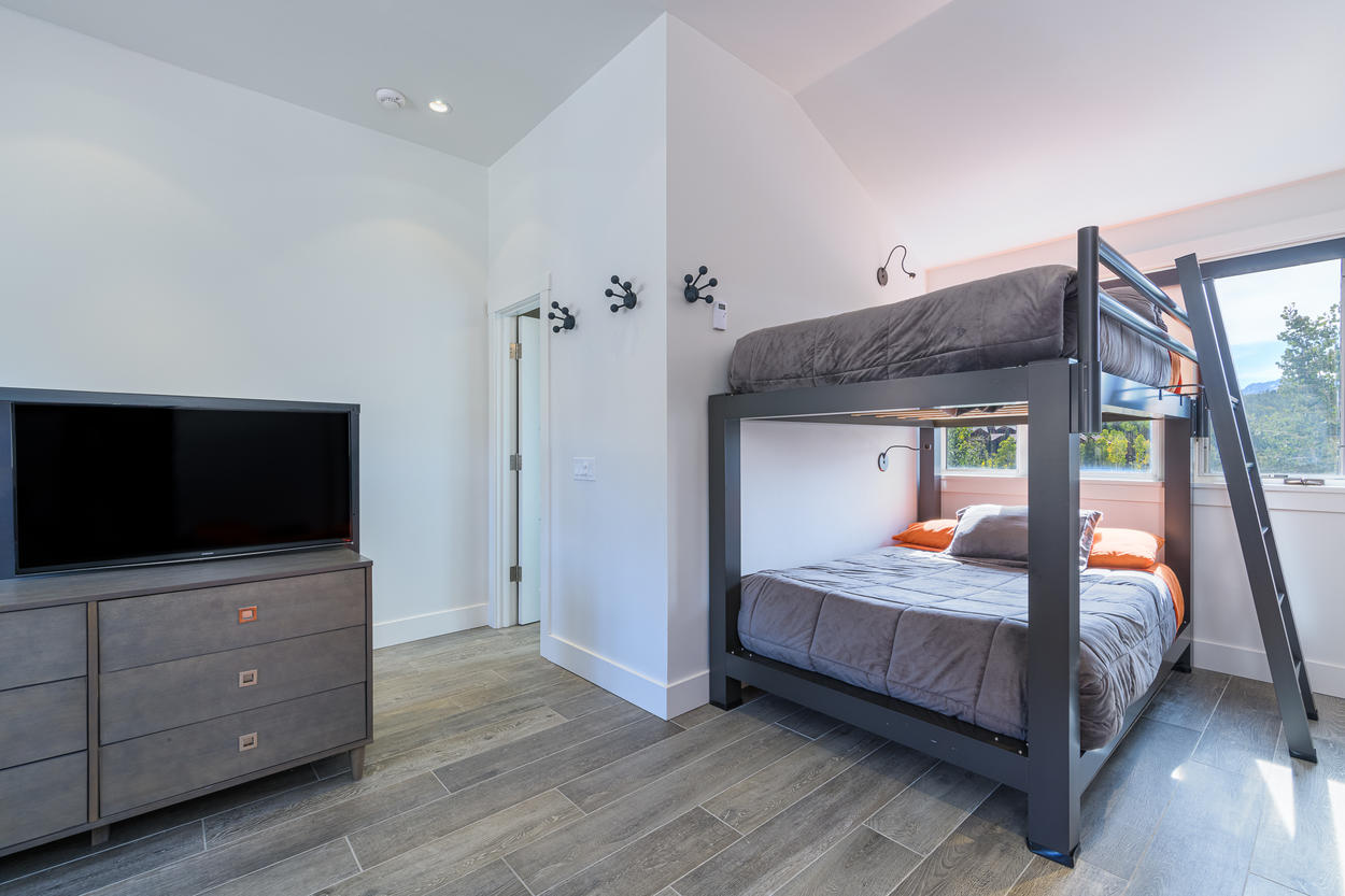 The top-floor bunk room has a full-over-full bunk set up and a large TV.