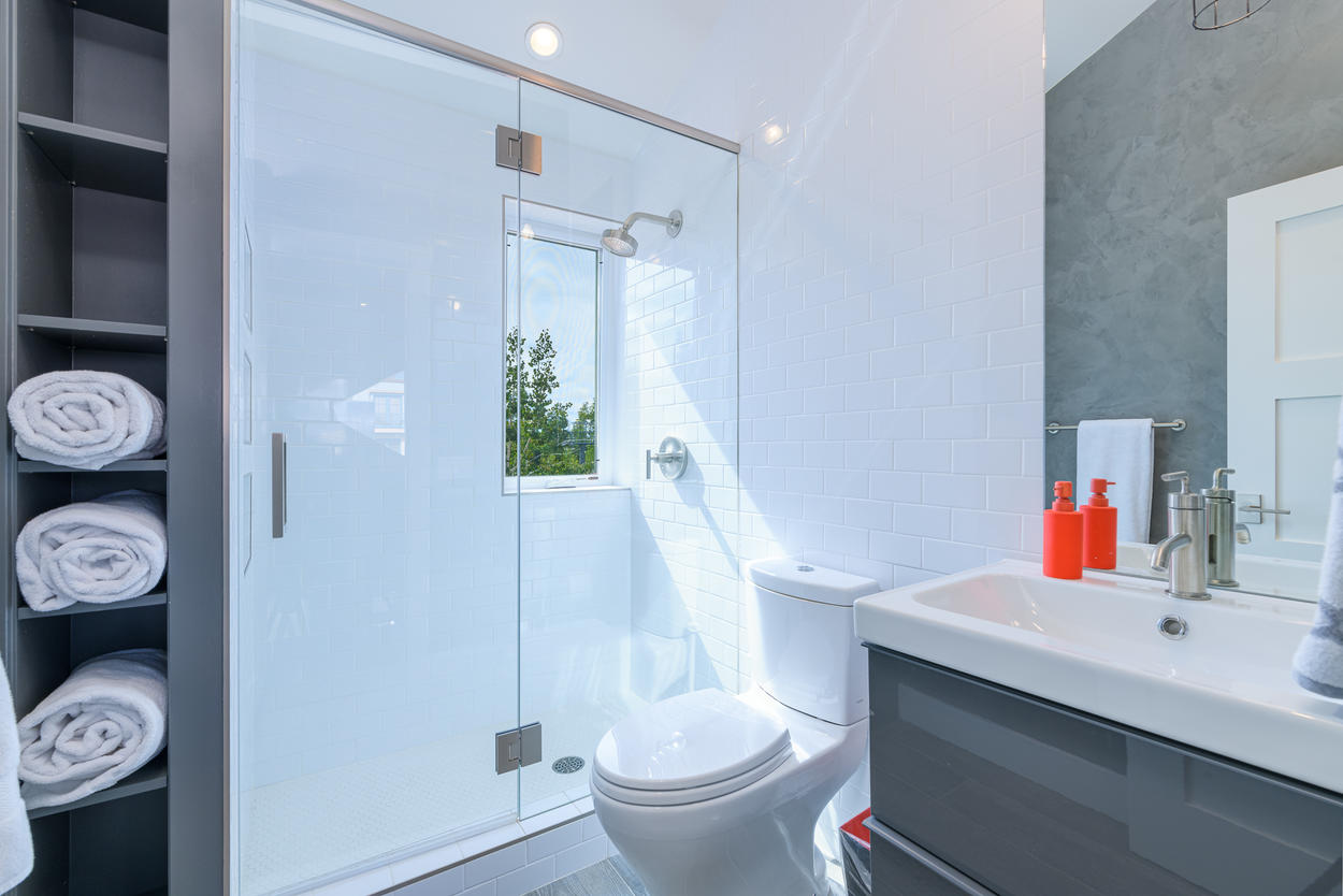 The Bunk Room ensuite has a glass walk-in shower and a single sink.