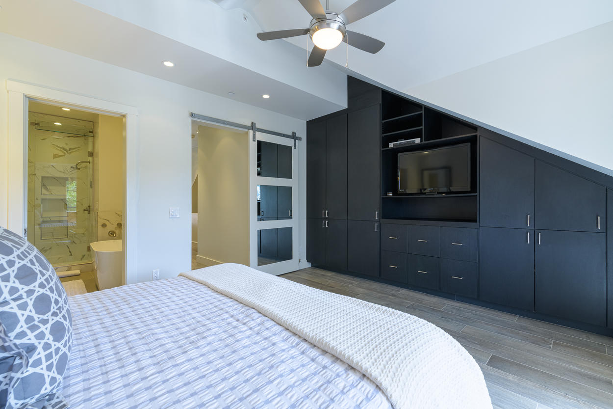 The Master Ensuite is found behind the modern sliding door.