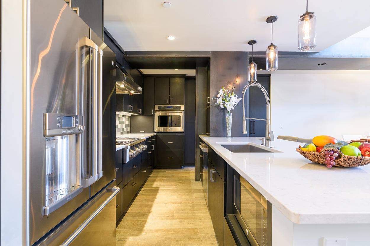 Keeping in theme with the sleek modern design, the kitchen's galley layout is perfect for both cooking and gathering.