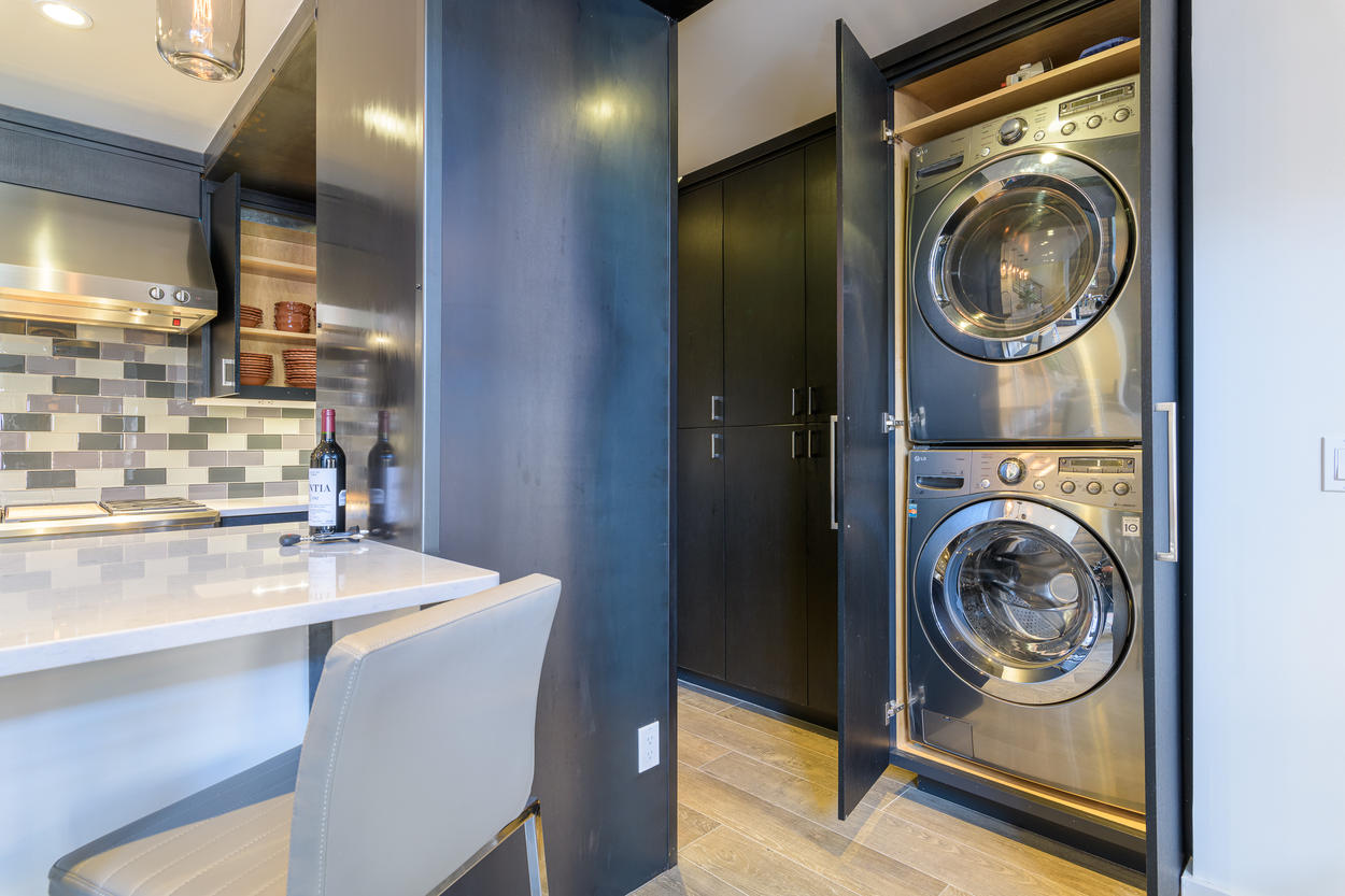 The laundry closet is tucked into storage just off from the kitchen.