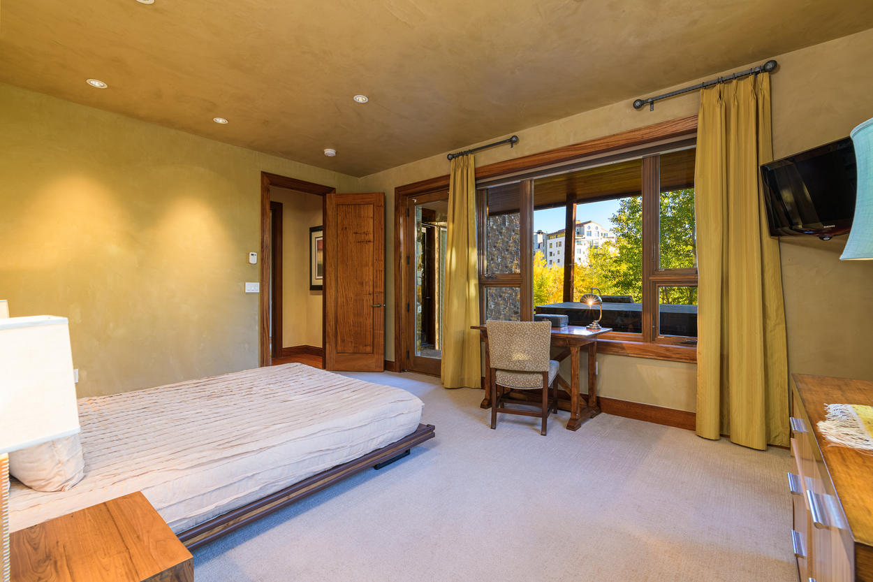 From the 1st floor guest queen room, step onto the lower level patio hot tub.