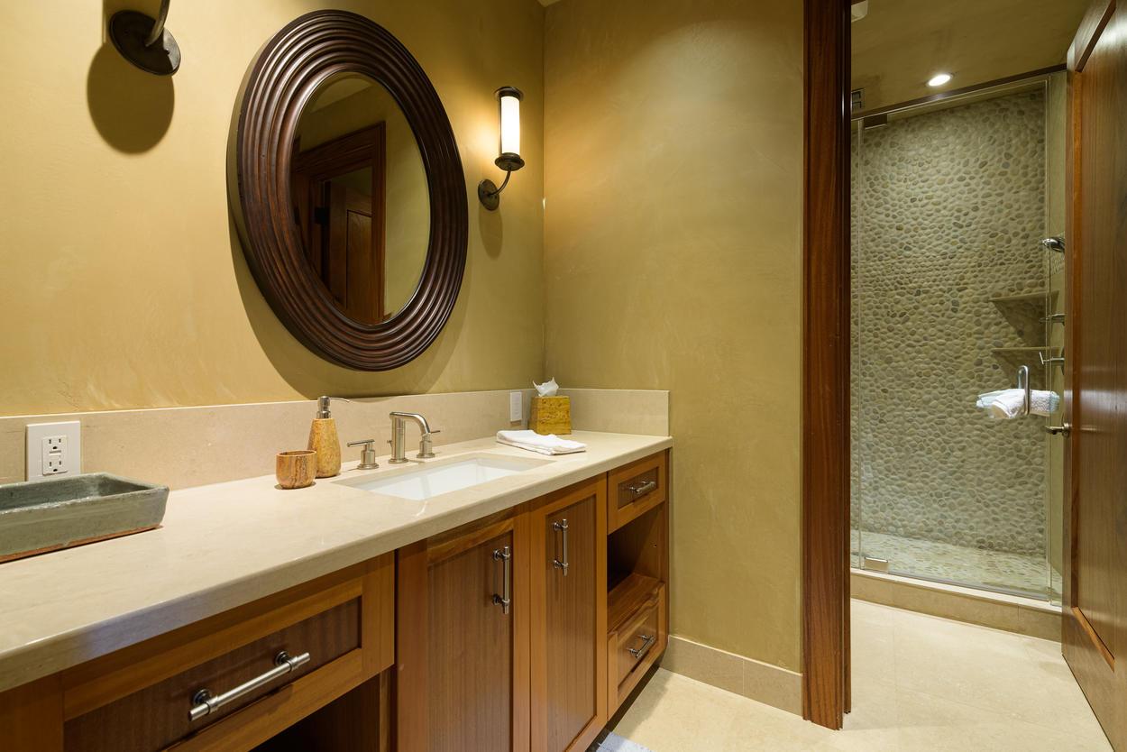 The 1st floor queen bedroom ensuite has a single sink and walk-in shower.
