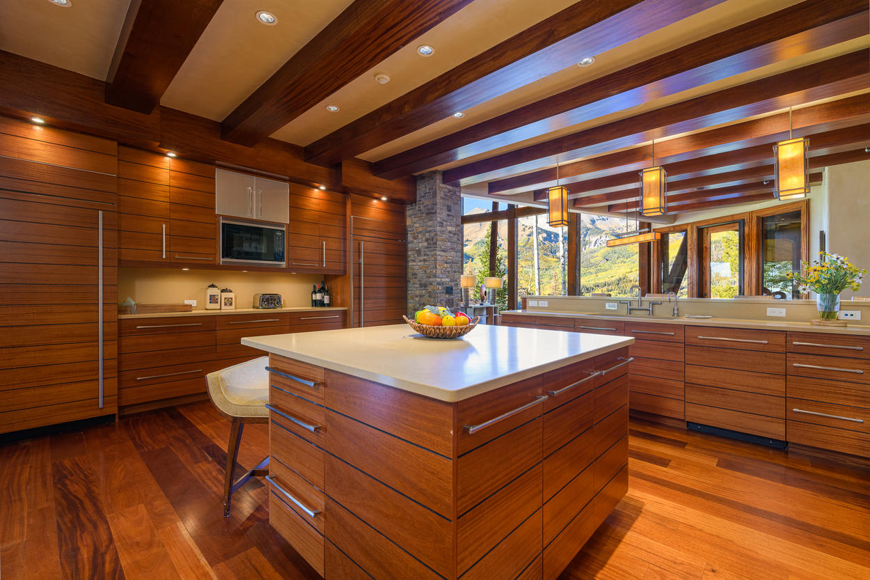 Custom design throughout the kitchen gives it a thoroughly modern feel, yet remains cozy with the natural wood.