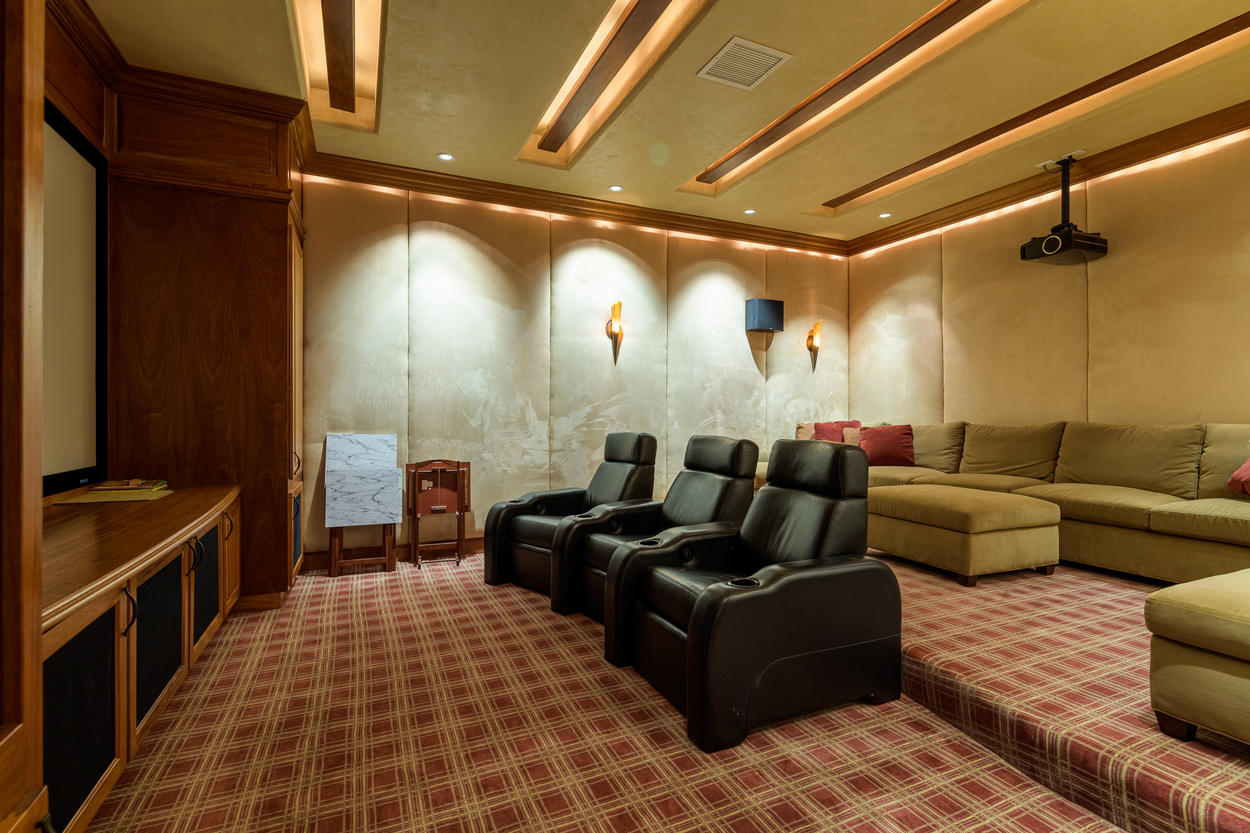 The theater room has sound-proofing walls and was designed for optimum acoustics.