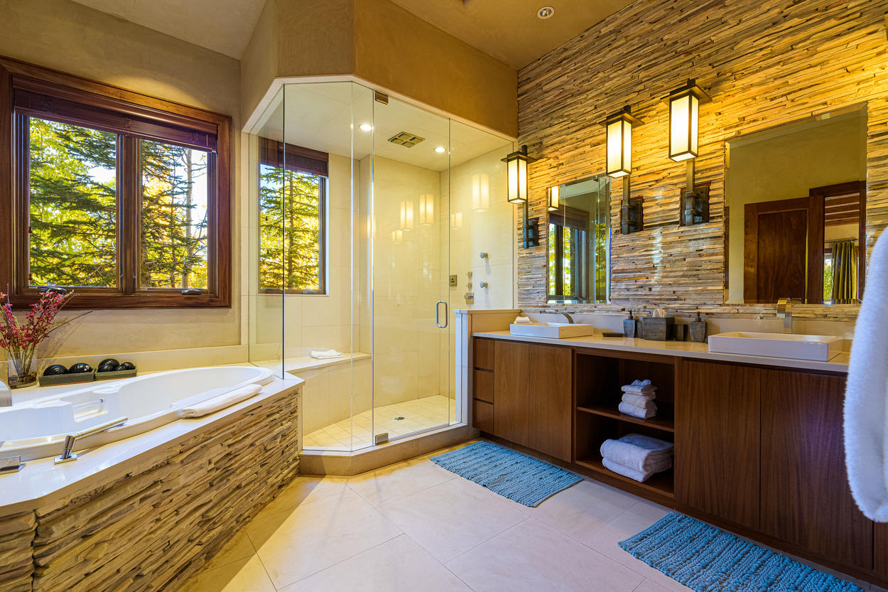 The ensuite of the 1st floor King Guest bedroom also has a large walk-in glass shower and tub.